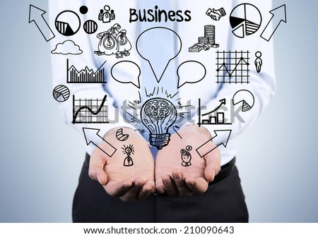 Young businessman holding a set of the graphs including pie chart, line graph, sketches etc. Business development concept.  - stock photo