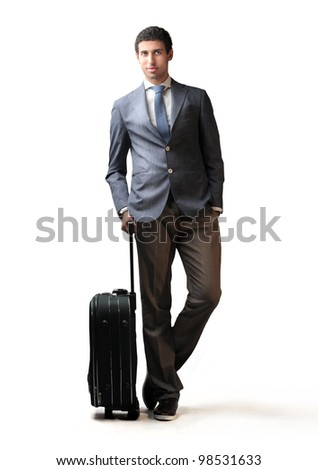 Young businessman holding a suitcase - stock photo