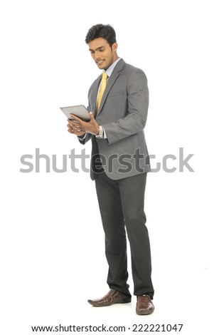 young businessman holding a tablet and watching screen  - stock photo