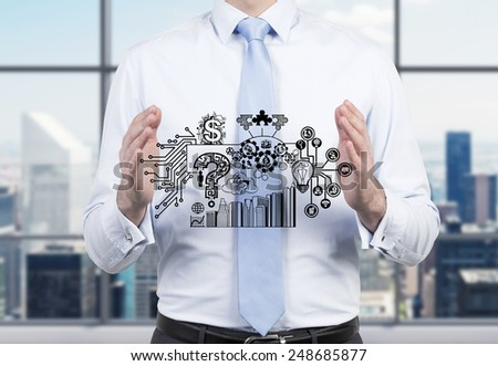 young businessman holding drawing business plan - stock photo