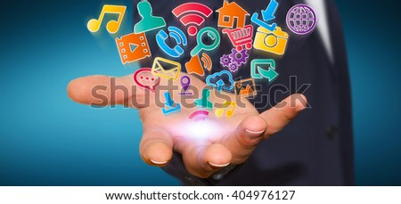 Young businessman holding modern digital icon application in his hand - stock photo