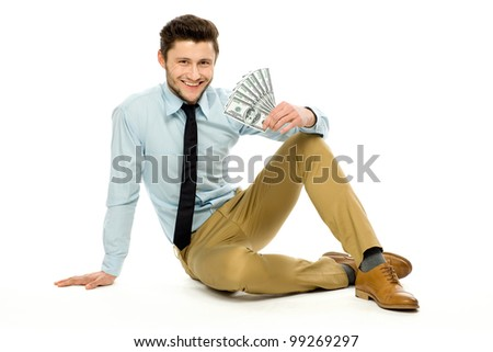 Young businessman holding money - stock photo