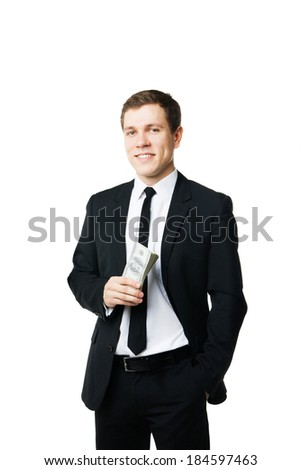 Young businessman holding money isolated over white background - stock photo