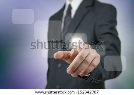 Young businessman in a black suit using virtual technology - stock photo