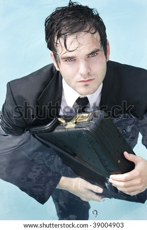 Young Businessman in a suit in the water - stock photo