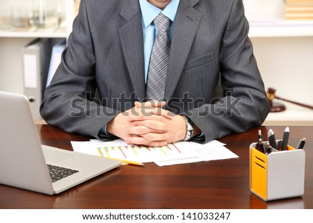 Young businessman in office at his workplace - stock photo