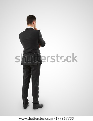 young businessman in suit thinking on a white background - stock photo