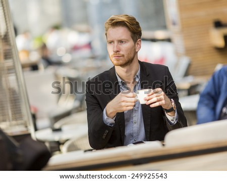 Young businessman in the cafe - stock photo
