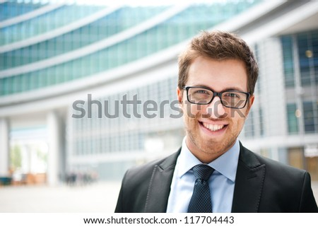 Young businessman in the city - stock photo