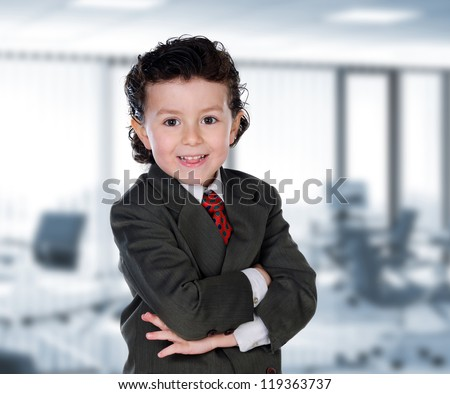 Young businessman in the office with an elegant suit - stock photo