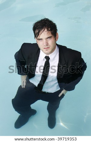 Young businessman in the water. - stock photo