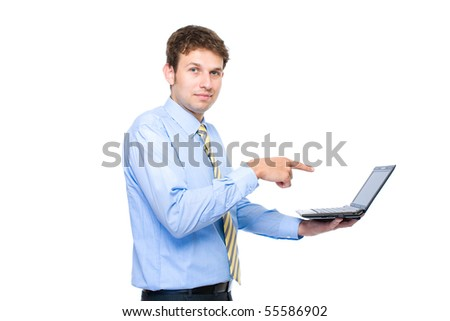 young businessman, it specialist points to screen of small laptop or netbook computer, studio shoot isolated on white background - stock photo