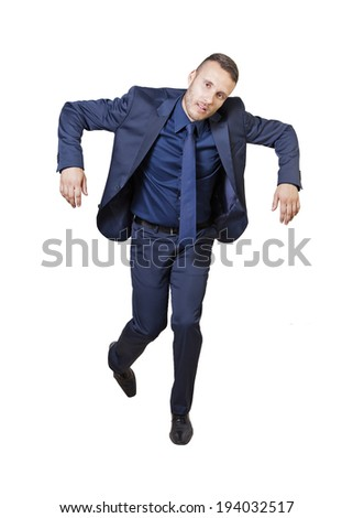 young businessman like a puppet isolated on a white background - stock photo