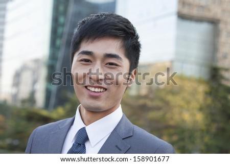 Young businessman looking at camera - stock photo