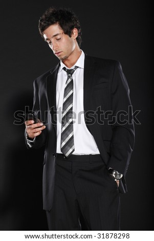 Young Businessman Looking at Phone - stock photo