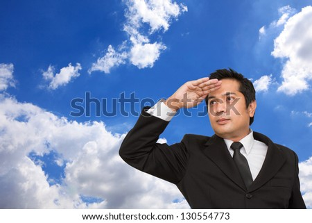 Young businessman looking far ahead - stock photo