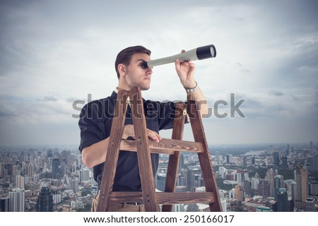 Young businessman looking for opportunities through the spyglass standing on the stairs.  Cloudy sky and city around. - stock photo