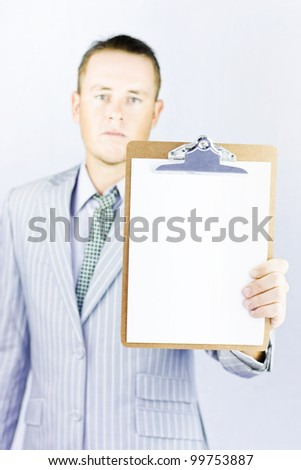 Young businessman looking thoughtful as he considers his latest decisions - stock photo