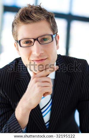 Young businessman looking to the camera wearing glasses - stock photo