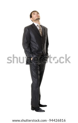 young businessman looking up  isolated on white - stock photo