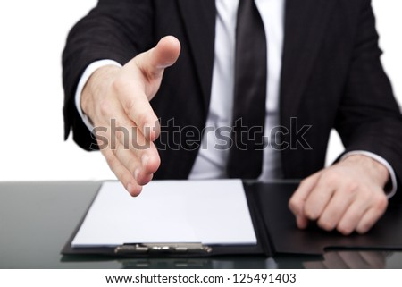Young businessman offering a handshake - stock photo