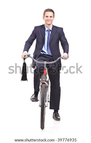 Young businessman on a bicycle isolated against white background - stock photo
