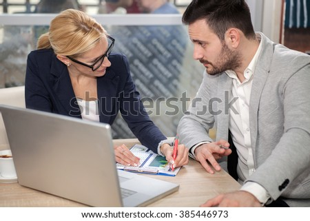 young businessman on a break at the restaurant, discuss new ideas and projects - stock photo