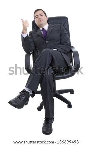 young businessman on a chair, isolated on white - stock photo