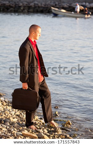 young businessman on summer holiday - stock photo