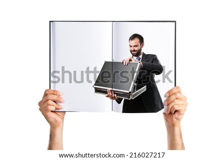 Young businessman open his briefcase printed on book - stock photo