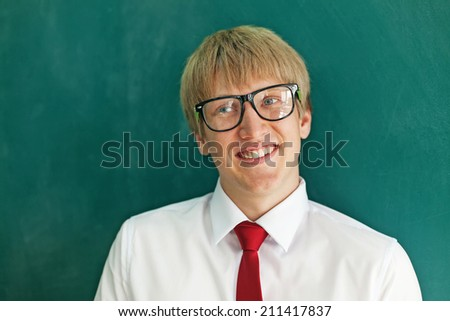 Young businessman over green wall - stock photo