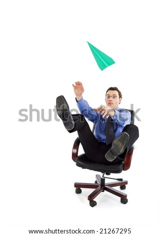Young businessman playing with paper airplane - isolated - stock photo