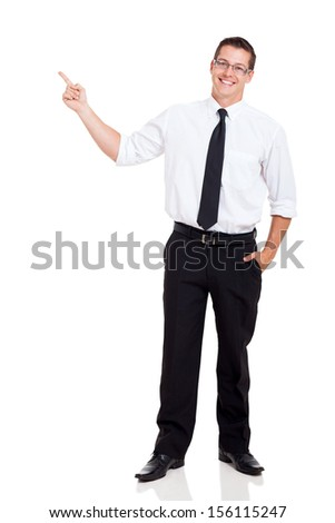 young businessman pointing at copy space over white background - stock photo