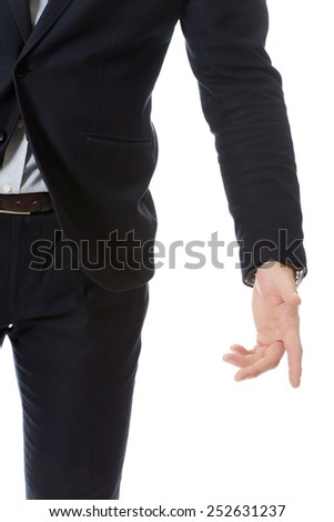 Young businessman pointing down on the floor. - stock photo