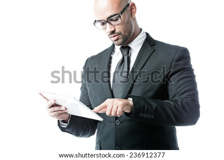 Young businessman pointing his finger on a touchpad isolated on white - stock photo