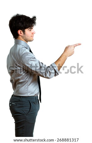 young businessman pointing on one side - stock photo