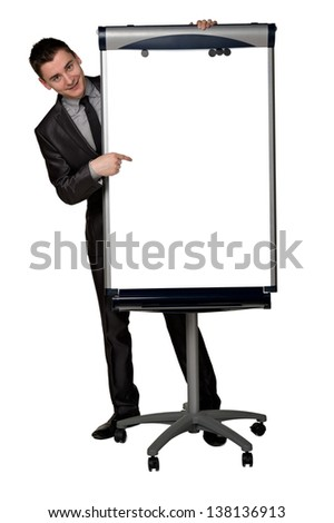 Young businessman pointing to the empty place on a white board. There is a copyspace or room for your text and/or graphic elements. - stock photo
