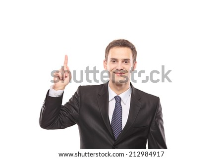 Young businessman pointing up with his finger isolated on white background - stock photo