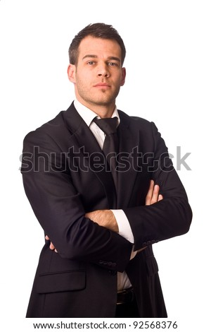 young businessman posing with crossed arms. - stock photo