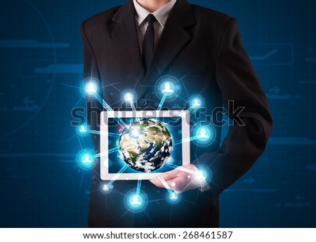 Young businessman presenting 3d earth globe in tablet - stock photo