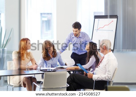 Young businessman presenting his idea to his colleagues.Teamwork. - stock photo
