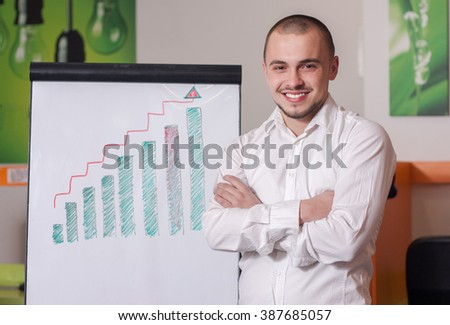 Young businessman presenting success chart - stock photo