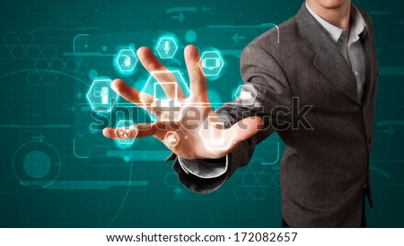 Young businessman pressing virtual media type of buttons - stock photo