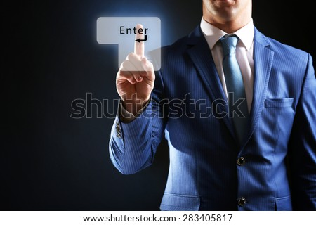 "Young businessman push ""Enter"" button - stock photo"
