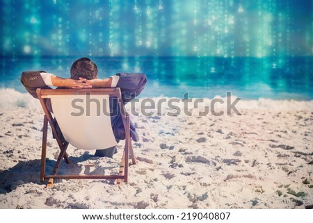 Young businessman relaxing on his sun lounger against lines of green blurred letters falling - stock photo