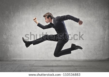 Young businessman running - stock photo