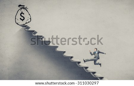 Young businessman running up on staircase with money bag on top - stock photo