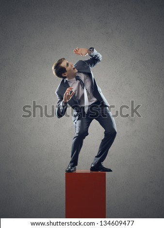 Young businessman scared, look up - stock photo