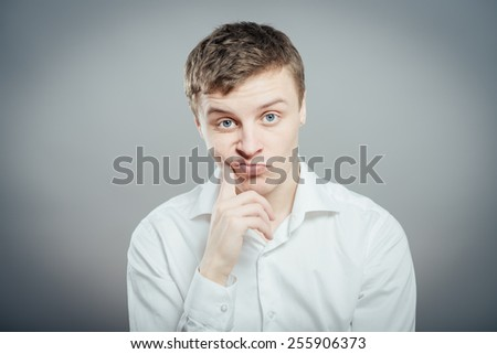 young businessman scratching his head, hard decision, studio shoot - stock photo