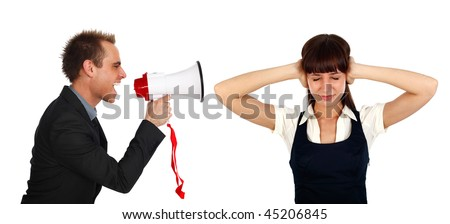 young businessman shooting at  a businesswoman  with a megaphone - stock photo